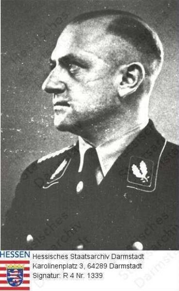 Jost, Heinz Dr. jur. (1904-1964) / Porträt in SS-Uniform, im Halbprofil, Brustbild