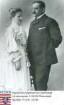 Hochgesand, Julius (1856-1921) / Porträt mit Ehefrau Elisabeth geb. Römheld (1860-1938), einander zugewandt, stehend, Kniestück